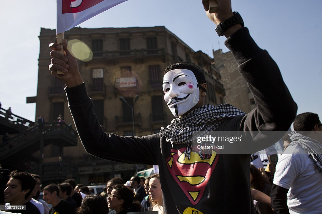 A protester wears a Guy Fawkes mask during a demonstration of students on February 11, 2012 in Cairo, Egypt. Egyptian people await the upcoming first anniversary of the resignation of the former Muhammad Hosni Mubarak after his 30-year term on 11 February last year. The poor economic condition of the country and the unrest in the past are a threat to the transition to a democracy.
