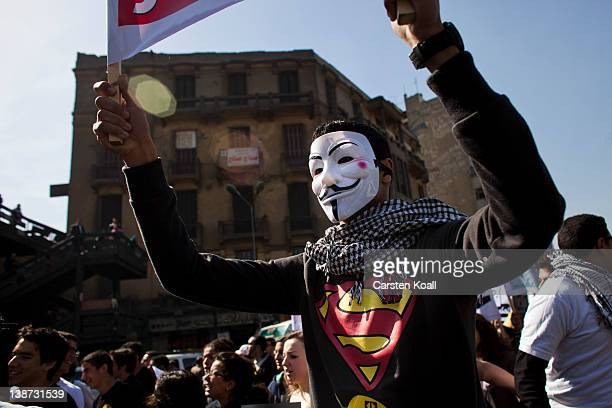 A protester wears a Guy Fawkes mask during a demonstration of students on February 11 2012 in Cairo Egypt Egyptian people await the upcoming first...