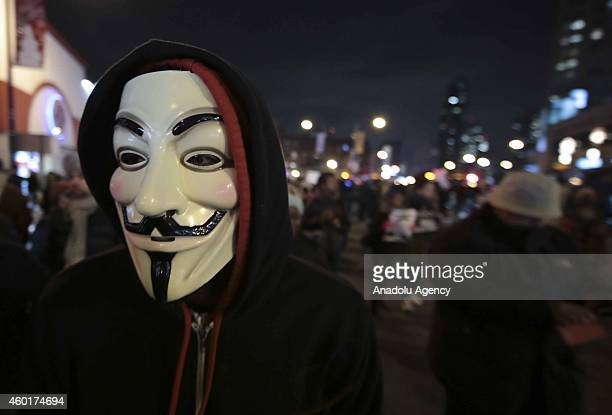 A protester wears a Guy Fawkes mask during a protest after a grand jury decided not to indict the police officer involved in the death of Eric Garner...