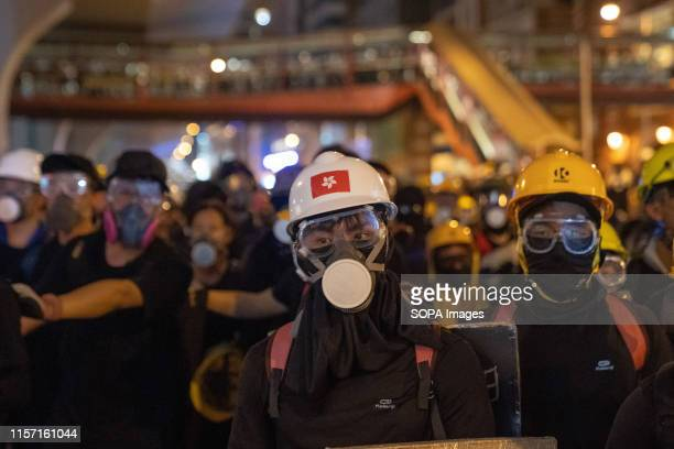 A protester wears a helmet with the flag of Hong Kong printed on it The Hong Kong police has used tear gas and rubber bullets against protesters as...