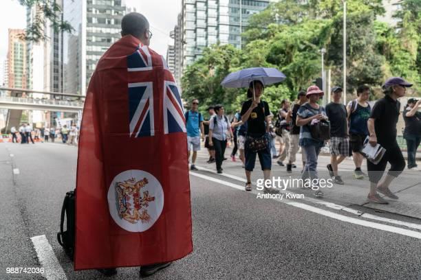 A protester wears a Hong Kong colonial flag during a rally on July 1 2018 in Hong Kong Hong Kong Hong Kong will mark 21 years since its return to...