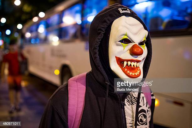 A protester wears a mask during a demonstration against the 2014 FIFA World Cup Brazil at Central do Brasil train station on March 27 2014 in Rio de...