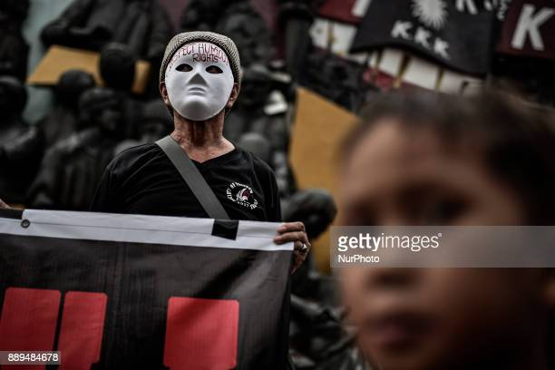 A protester wears a mask during Human Rights Day protests in Manila Philippines December 10 2017 On International Human Rights Day thousands of...