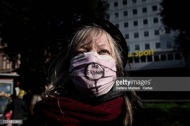 Protester wears a mask with an anti-Erdogan message during a demonstration of the feminist movement and the Kurdish people against Turkey's decision...
