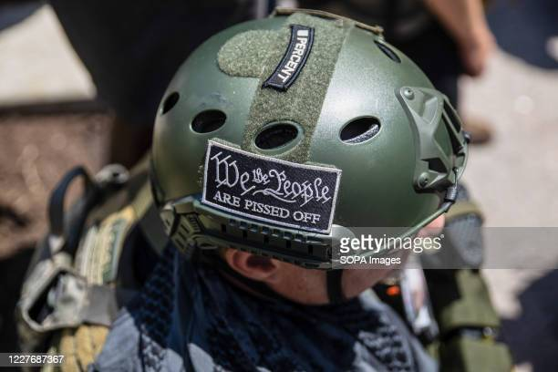 Protester wears a patche on a protective helmet written on it 'We The People Are Pissed Off' during an 'Anti-Mask' rally at Ohio Statehouse. Over 200...