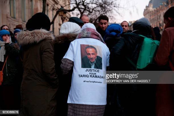 A protester wears a shirt reading 'Justice for Tariq ramadan' during a gathering in support of Islamic scholar Tariq Ramadan who is detained on rape...