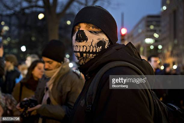 A protester wears a skeleton scarf near Franklin Square during a demonstration after the 58th presidential inauguration in Washington DC US on Friday...