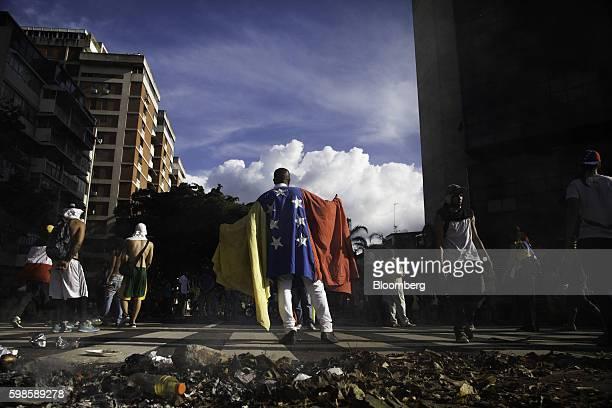 A protester wears a Venezuelan flag in the Altamira neighborhood of Caracas Venezuela on Thursday Sept 1 2016 Venezuelans took to the streets of...