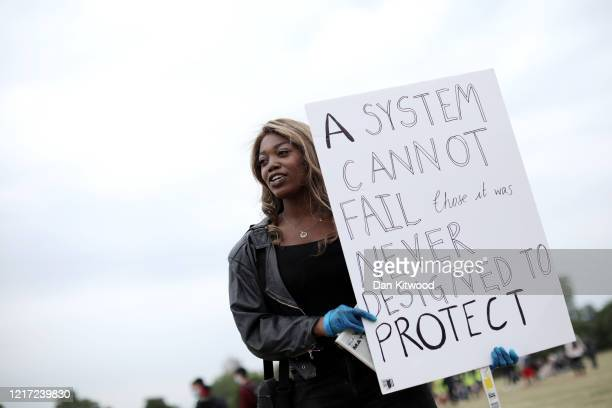 A protester wears gloves during a Black Lives Matter protest in Hyde Park on June 3 2020 in London United Kingdom The death of an AfricanAmerican man...