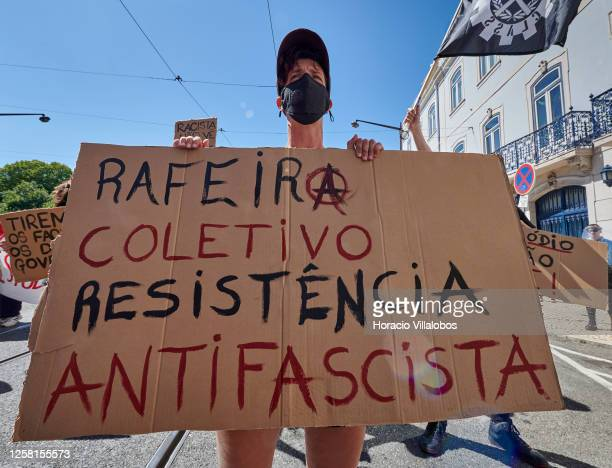Protester wears her protective mask and holds an antifascist sign during a rally to demonstrate against Fascism, Nazism and racism on July 25, 2020...