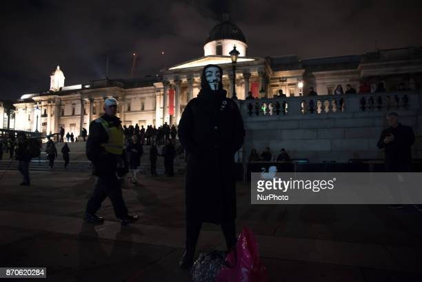A protester wears the Guy Fawkes mask in Trafalgar Square during the anticapitalist 'Million Masks March' organised by the group Anonymous to protest...
