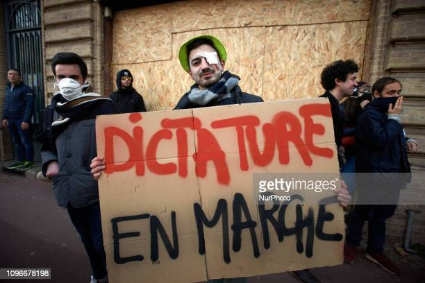 A protester wioth a false injury holds a placard reading 'Dictorship 'Onward'' Act XIII dubbed 'Civil disobediencequot' of the Yellow Vest movement...
