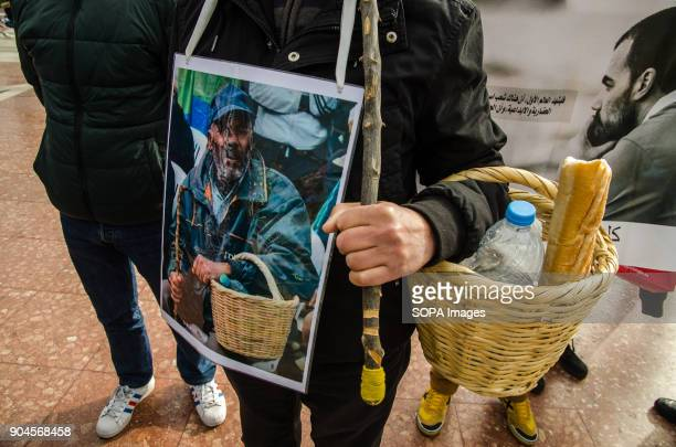 A protester with a basket with bread and water in memory of a popular protester arrested in the Rif and currently in prison Third March in Barcelona...