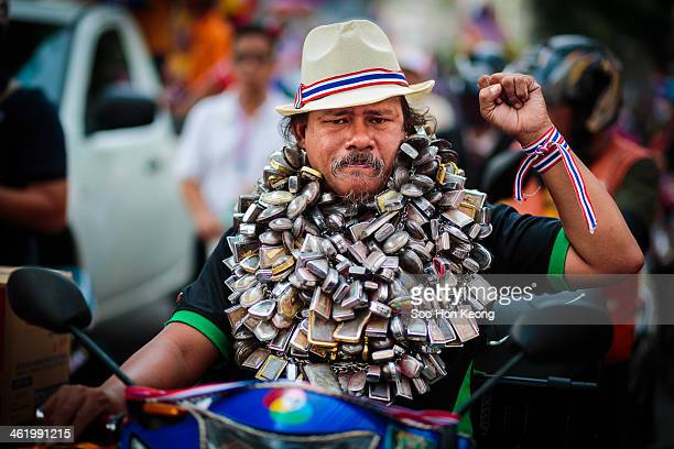 CONTENT] A protester with a body of amulets during the march where thousands of anti government protesters lead by Suthep Thaugsuban take part in a...