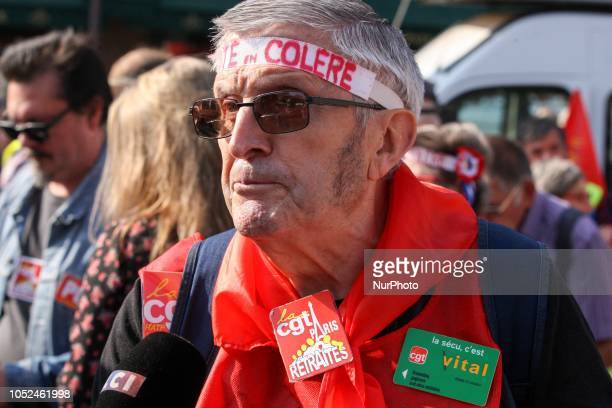 A protester with a headband reading « angry retired people » gathers near the Opera House during a demonstration called by pensioners' unions on...