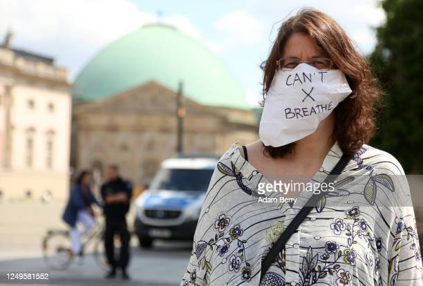 A protester with a mask reading Can't Breathe a reference to the last words of George Floyd murdered by police in Minneapolis attends the Unteilbar...