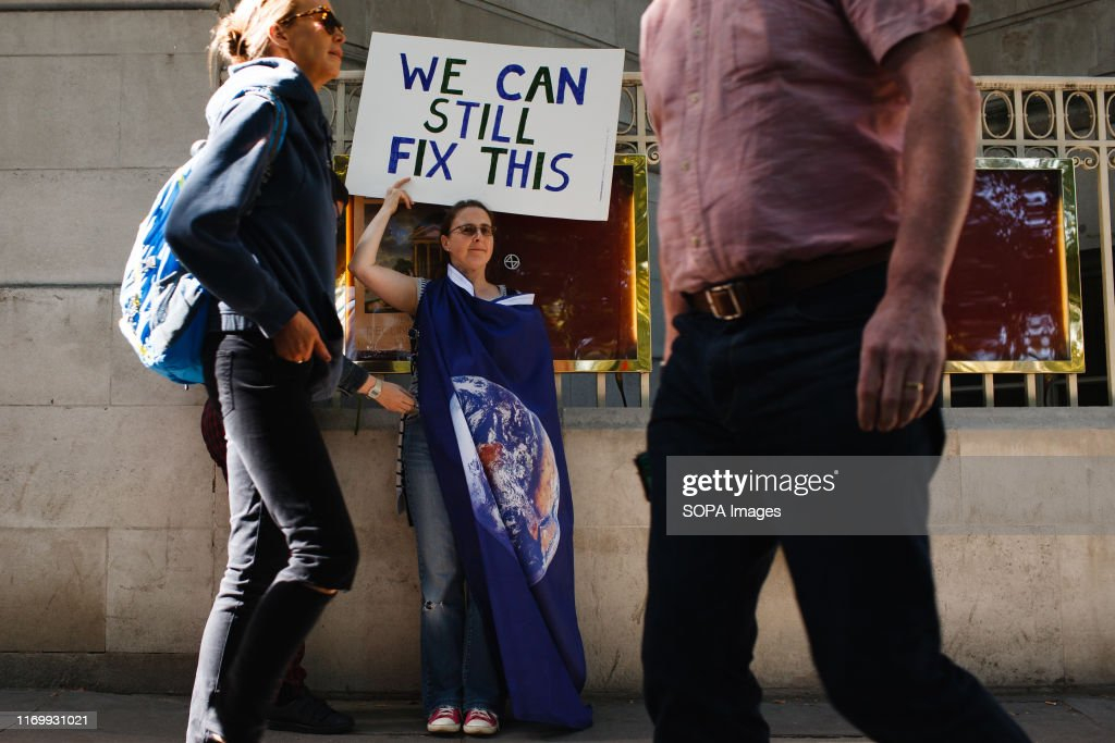 A protester with a placard at Millbank during the... : News Photo