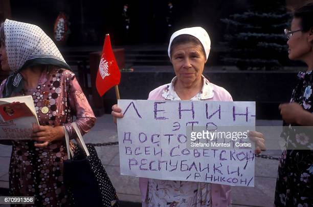 A protester with a sign in hand where it is written Lenin the dignity of the Soviet Republic Richard Nixonu201d during thensitin of the Russian...