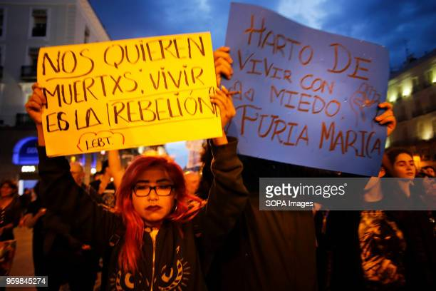 Protester with a sign that says 'We Want to DieLiving is the Rebellion' Hundreds of demonstrators took to the streets of Madrid to demand LGBT and...