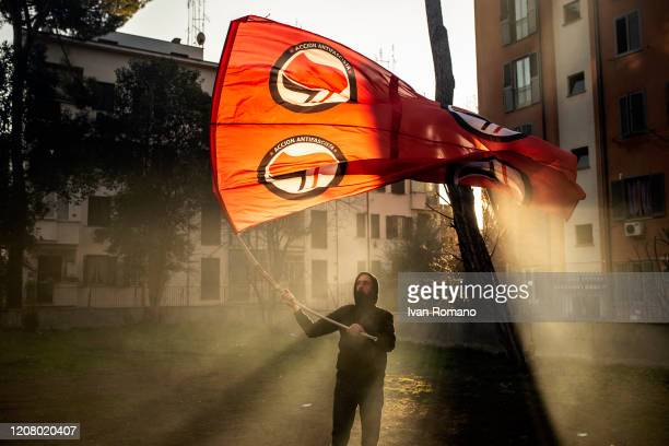A protester with an antifascist flag attends the march in memory of Valerio Verbano on February 22 2020 in Rome Italy Every February 22nd in Rome the...