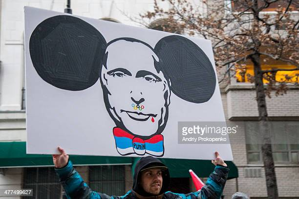 CONTENT] A protester with an antiPutin poster depicting Putin's face with the Olympic rings blood and Cheburashka ears during a mass demonstration...