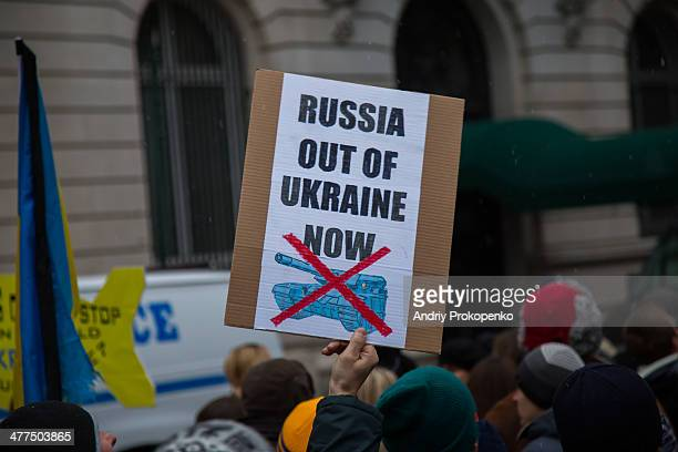 CONTENT] A protester with an antiwar poster saying Russia out of Ukraine now and depicting a crossed tank during a mass demonstration against Russian...