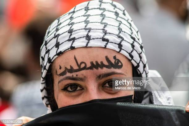 Protester with her face painted during a demonstration against the last attacks by Israel to Palestinian people and coinciding with the 73rd...