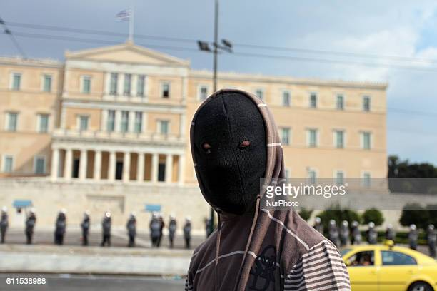 Protester with his face covered in anti austerity protests in Athens Greece Massive demonstrations on a day of general strike against the additional...