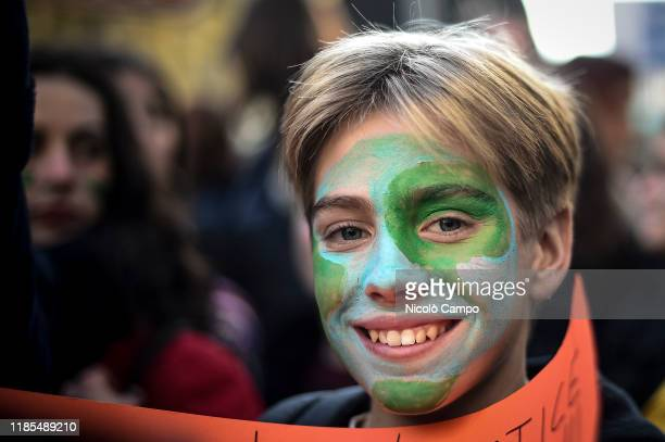 Protester with painted face smiles during 'Fridays for future' demonstration, a worldwide climate strike against governmental inaction towards...