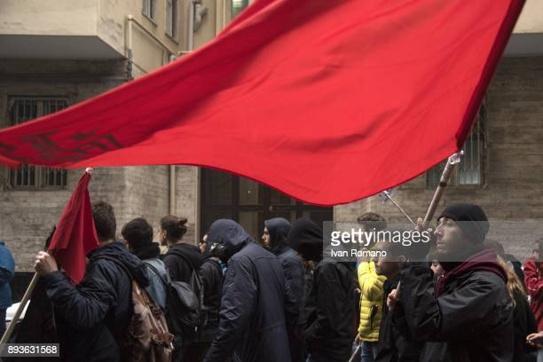 Protester with the red flag of the Je So Pazz movement during a demonstration in the streets of Naples against the General States of the workschool...