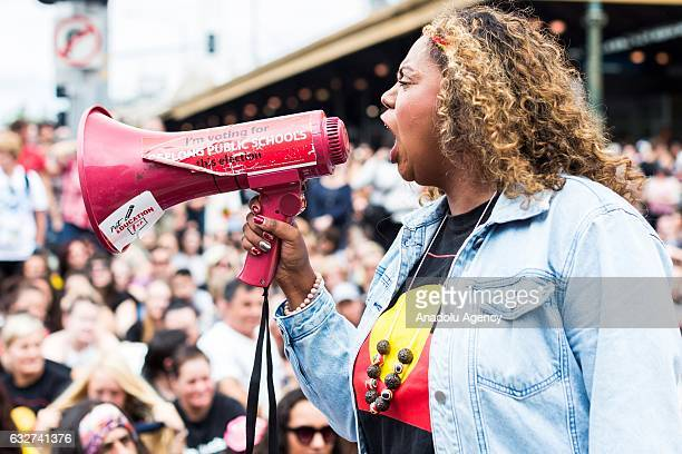 A protester woman speaks into a megaphone during a protest organized by Aboriginal rights activists on Australia Day in Melbourne Australia on...