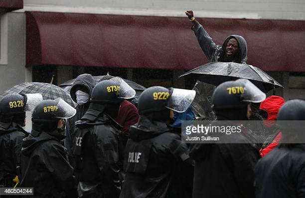 A protester yells at a line of Oakland police officers during a demonstration over recent grand jury decisions in policeinvolved deaths on December...