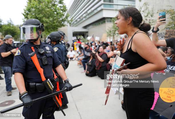A protester yells at a San Jose Police officer during a protest for the killing of George Floyd outside of San Jose City Hall in downtown San Jose...