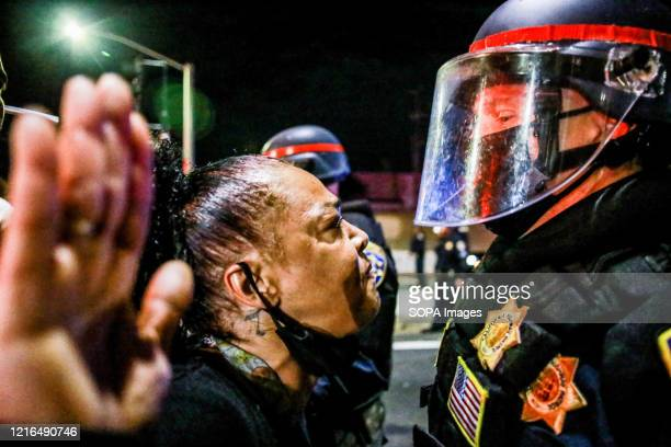Protester yells in the face of a police officer during the demonstration. A peaceful protest, spurred by the death of George Floyd, turned violent as...