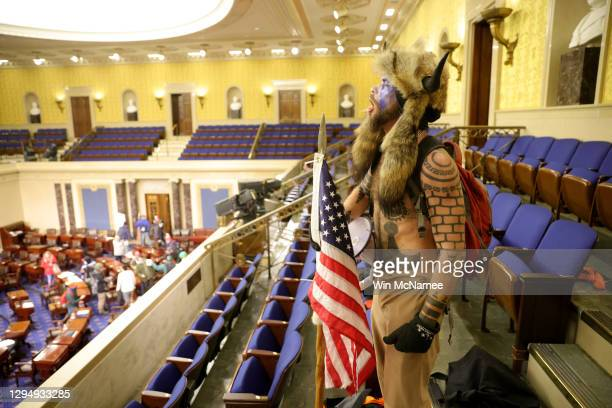 Protester yells inside the Senate Chamber on January 06, 2021 in Washington, DC. Congress held a joint session today to ratify President-elect Joe...