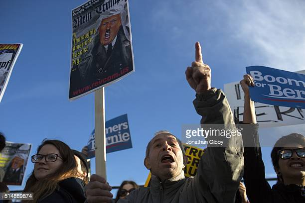 A protester yells outside the of the University of Illinois at Chicago Pavilion where Republican presidential candidate Donald Trump is due to speak...