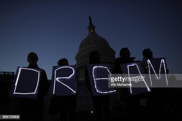 Protesters advocating for the DREAM Act hold a candlelight vigil outside the US Capitol on January 18 2018 in Washington DC Congress continues to...