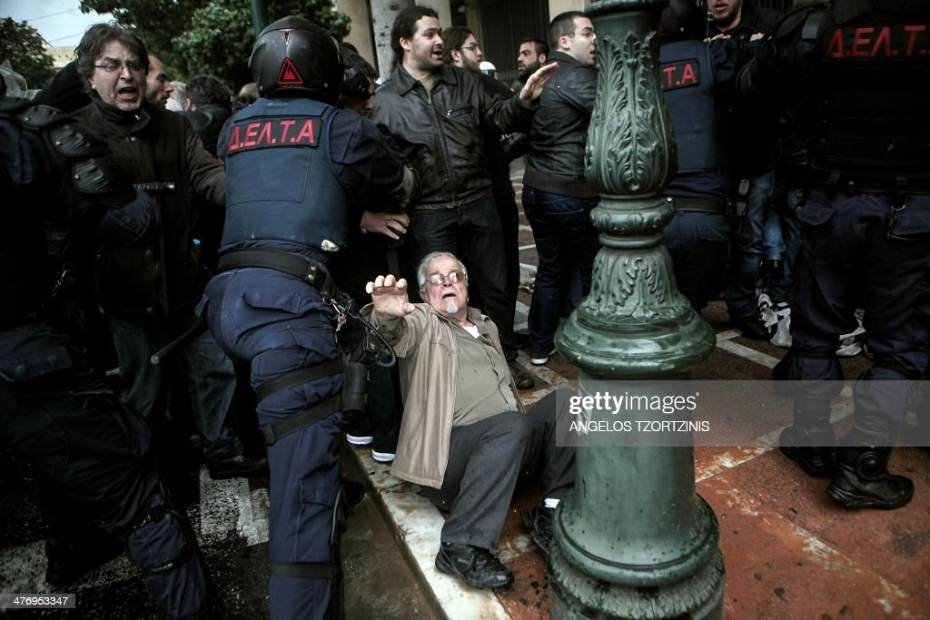 Protesters affiliated to the communist party clash with riot police during a demonstration against austerity measures in Athens on March 6, 2104.