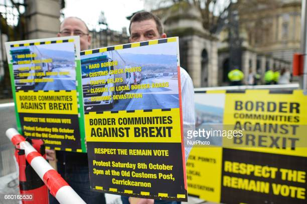 Protesters against a hard border between the Republic of Ireland and the Northern Ireland stands outside the Leinster House in Dublin on the day when...