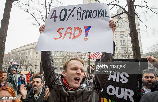 Protesters against and supporters of Donald Trump gather prior to the presidential inauguration in front of the Trump Hotel on January 20 2017 in...