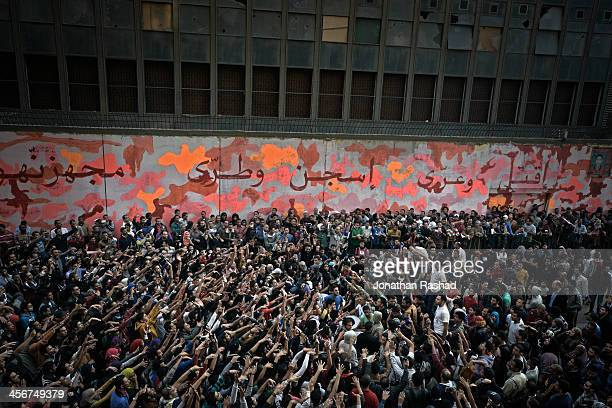 Protesters against both military and Muslim brotherhood chant on Mohamed Mahmoud street off Cairo's Tahrir Square on the second anniversary of...