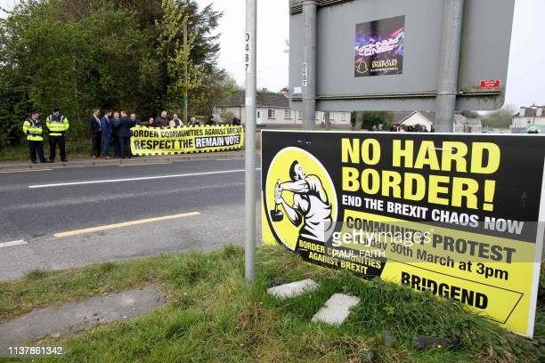 Protesters against Brexit and the possible imposition of any hard border between Northern Ireland and Ireland gather with a banner at the border...