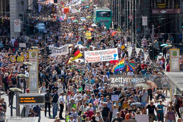 """Protesters against coronavirus restrictions march on August 01, 2020 in Berlin, Germany. The demonstration has been named """"The end of the pandemic —..."""