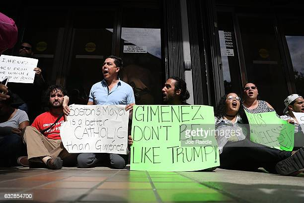 Protesters against MiamiDade Mayor Carlos Gimenez's decision to abide by President Donald Trump's order that any 'sanctuary' cities could possibly...