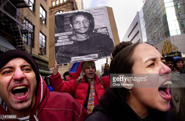 Protesters against police violence Udit Kondal left and Maegan Lortiz right shout as they make their way down Broadway in New York City April 5 2000...