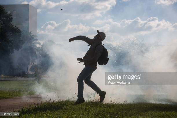 Protesters against President Michel Temer clashed with the police during a protest for direct elections in Planalto on May 24 2017 in Brasilia Brazil...