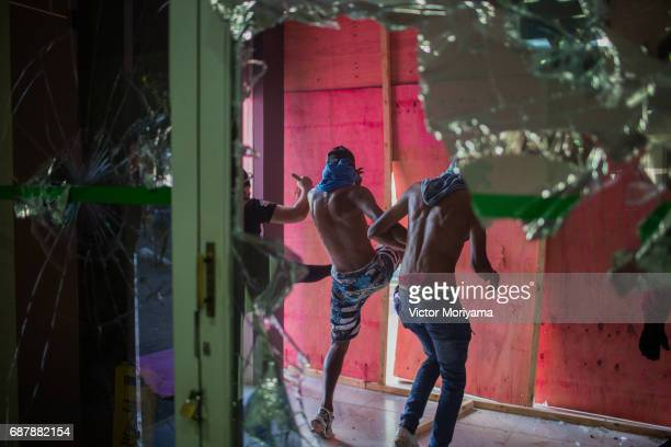 Protesters against President Michel Temer vandalize the Ministry of Agriculture as they clash with police during a protest for direct elections in...