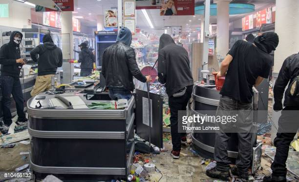 Protesters against the G20 Summit plunder and destroy a Rewe supermarket in the Schanzenviertel district on July 7 2017 in Hamburg Germany Leaders of...