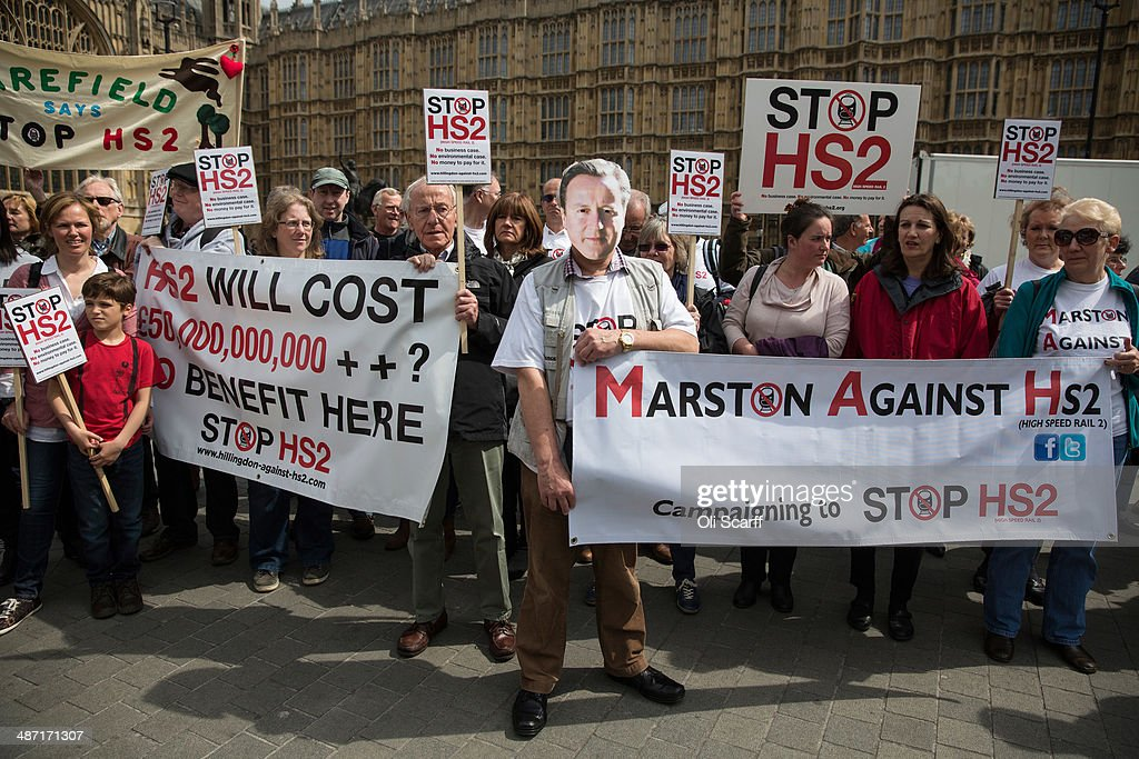 Protesters against the Government's proposed high-speed rail link (HS2) demonstrate outside the Houses of Parliament on April 28, 2014 in London, England. Members of the House of Commons will vote later today on the HS2 bill's second reading with 30 Conservative MPs threatening to vote against the Government's pro-HS2 stance.