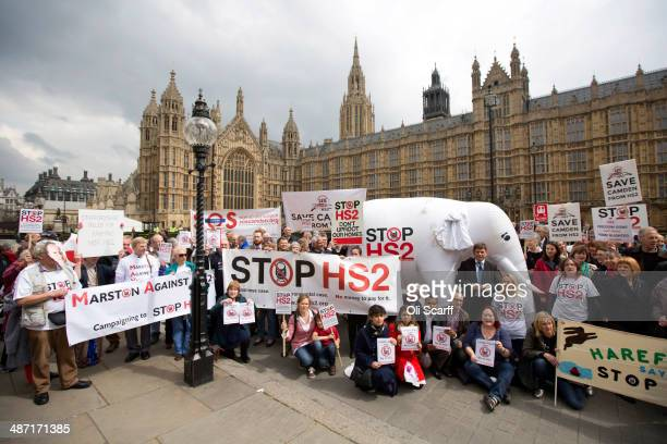 Protesters against the Government's proposed highspeed rail link demonstrate outside the Houses of Parliament on April 28 2014 in London England The...
